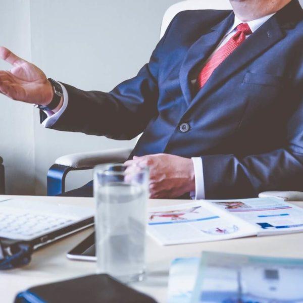 Business man sat at desk in suit